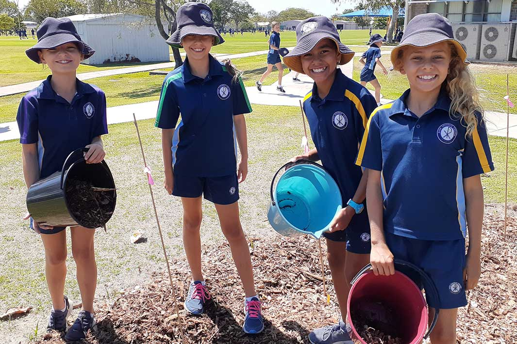 Group of school children working on outdoor learning project