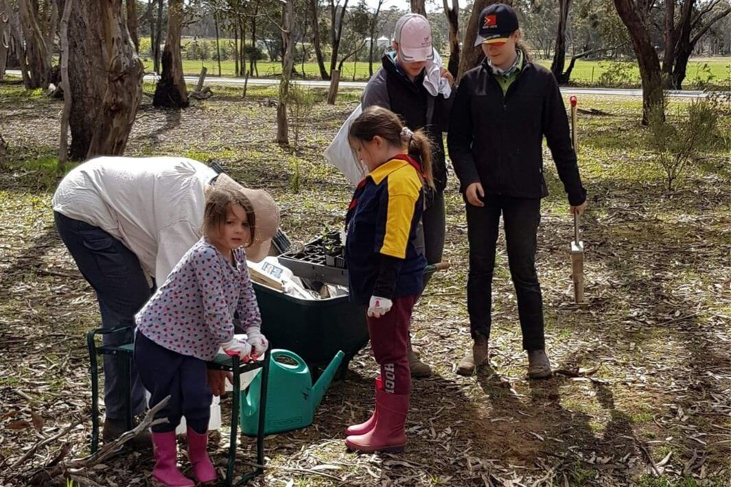 young students working on junior landcare